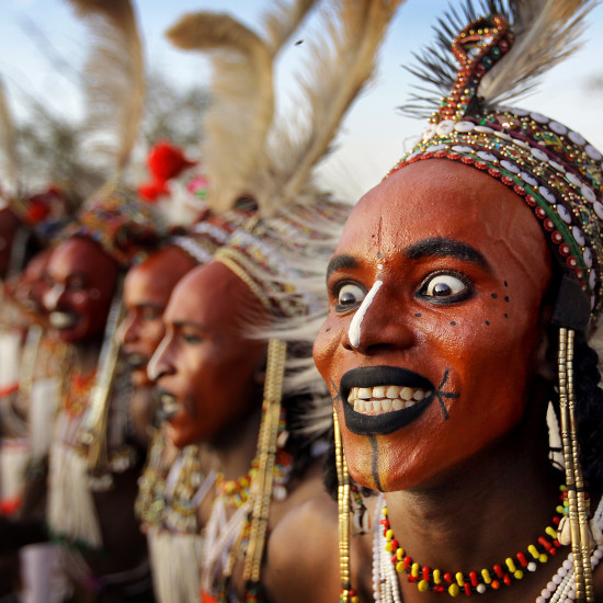 The Wodaabe, a nomadic tribe of cattle herders inhabiting (amongst other places) the deserts of Eastern Niger, meet for a Gerewol, at which the men dress up extravagantly and paint their faces in order to appeal to the women of the tribe.  The men dance traditional dances for 5 days during which a select group of women judge and choose the most beautiful men.  Location: Remote dersert near Nguigmi (Lake Chad Area), Eastern Niger, Africa Pic: Copyright Timothy Allen Tel. +44 (0)7808 063326 http://humanplanet.com sent to TRVL - single usage license