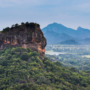 Sigiriya Rock Fortress, seen from Pidurangala Rock, Sri Lanka, Asia. This is a photo of Sigiriya Rock Fortress, seen from Pidurangala Rock, Sri Lanka, Asia. Sigiriya Rock Fortress, located in the 'cultural triangle' is the most popular tourist attraction in Sri Lanka. Pidurangala Rock, just opposite offers an extremely impressive view over Sigiriya Rock and the surrounding Sri Lanka landscape. It is hard to believe that Sigiriya Rock Fortress used to be the inside of a volcano.