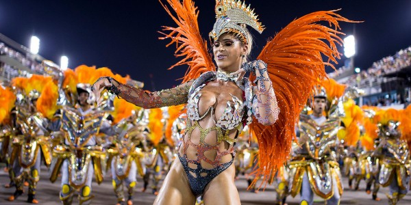 """RIO DE JANEIRO, BRAZIL - MARCH 03: Members of Unidos da Tijuca Samba School during their parade at 2014 Brazilian Carnival at Sapucai Sambadrome on March 03, 2014 in Rio de Janeiro, Brazil. Rio's two nights of Carnival parades began on March 2 in a burst of fireworks and to the cheers of thousands of tourists and locals who have previously enjoyed street celebrations (known as """"blocos de rua"""") all around the city. (Photo by Buda Mendes/Getty Images)"""
